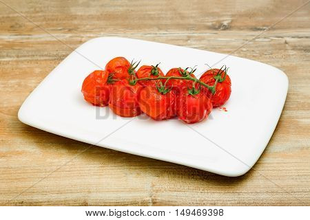 Succulent grilled cherry tomatoes ready to be served as a vegetable with a meal