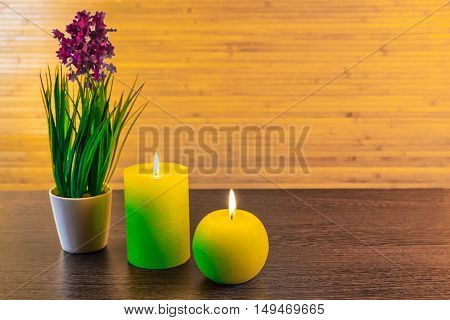 Green spa concept with candles and flowers