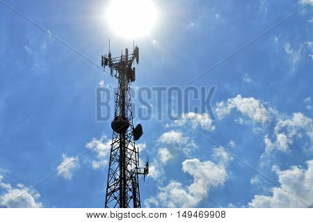A communications tower under the bright sun