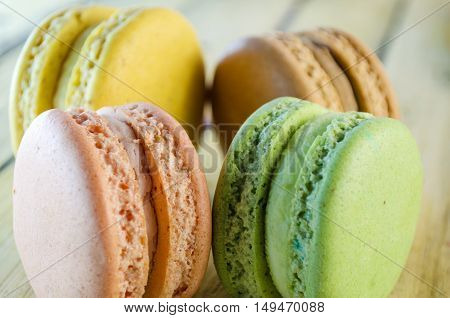 colorful cookies Macaroon on a wooden table