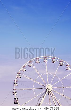 Picture Of A Ferris Wheel Against Blue Sky.