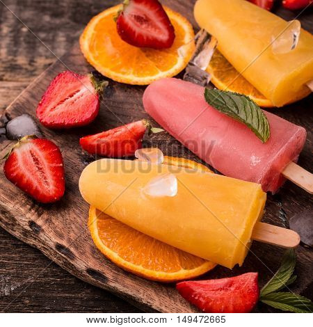 Refreshing Fruit Popsicle Lollies On Wooden Table With Berries And Fruits