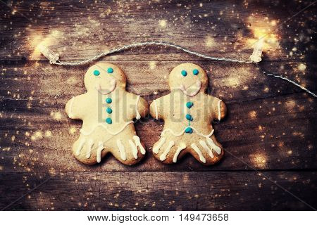 Christmas greeting card with gingerbread man cookie and snowstorm