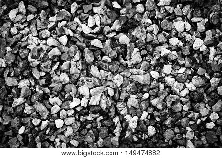Crushed grey stone in black and white back ground texture