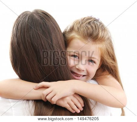 Cute girl hugging mother on white background