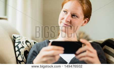 Happy Woman With A Smartphone
