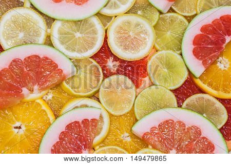 Fresh delicious colorful slices of citrus. Healthy eating, diet, vitamins, natural background