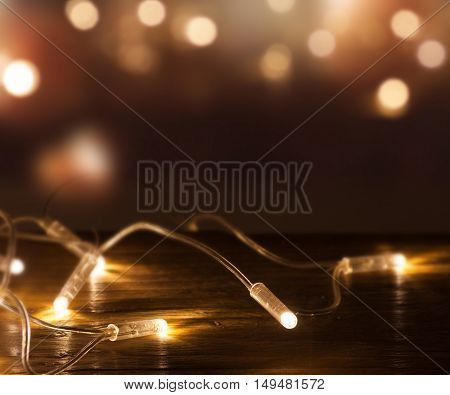 String of lights in front of a festive background with bokeh