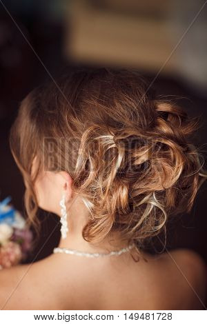 Closeup photo of perfect bride's hairstyle. Stock photo.