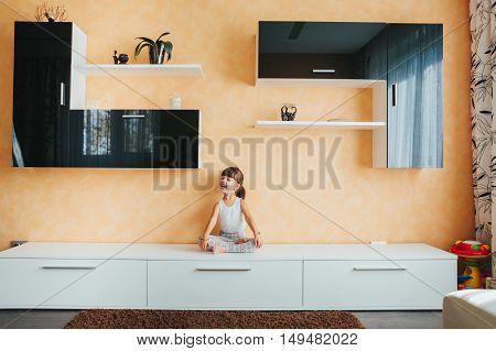 girl doing yoga on the furniture. lotus.Yoga