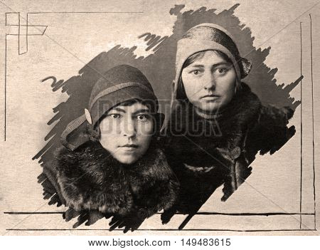 A vintage photo portrait from 1928 of Russian sisters.