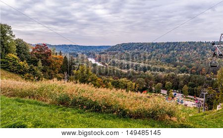Autumn panorama of landscape with river and clouds