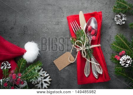 Christmas silverware at dark slate table. Top view copy space.
