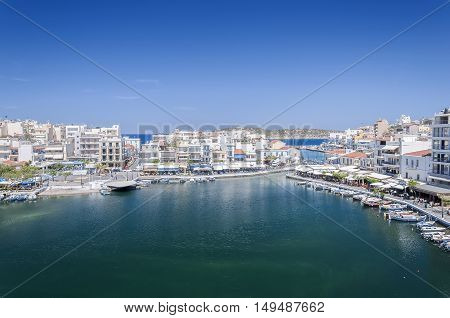 AGIOS NIKOLAOS CRETE GREECE - MAY 6 2015: Seaside resort town of Agios Nikolaos located on the north-east side of Crete Greece.