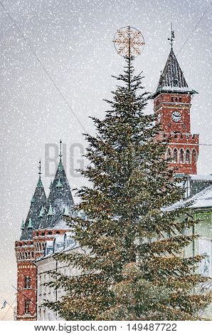 A view of the swedish city of Helsingborg Town Hall and christmas tree during some wintry weather conditions.