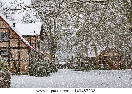 Houses situated at ramlosa brunnspark on the outskirts of Helsingborg in Sweden during a heavy snowfall.