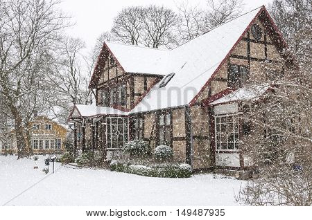 A snow covered house situated at ramlosa brunnspark on the outskirts of Helsingborg in Sweden.