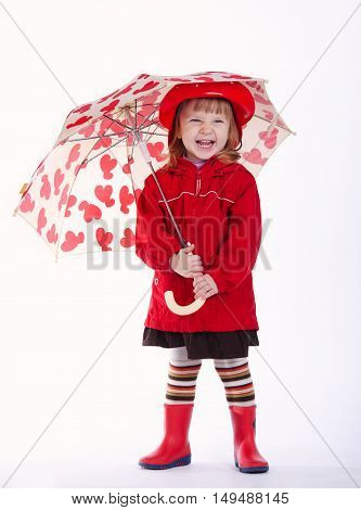 photo of beautiful little girl with umbrella