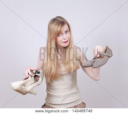 Young woman showing comfortable flat shoes after taking off high heals
