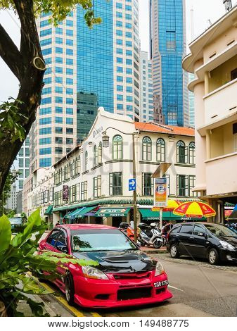 SINGAPORE, REPUBLIC OF SINGAPORE - JANUARY 09, 2014: Street view of Chinatown Singapore city. Road traffic, old colonial and modern buildings