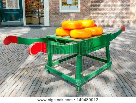 Yellow circles of cheese lying on a stretcher in the middle of the street.