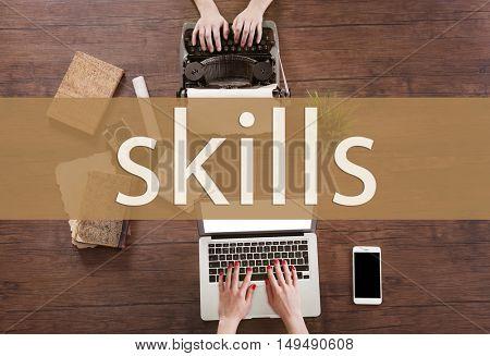 Skills. Old typewriter and laptop.