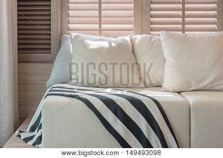 White Color Set Of Pillows And Sofa In Modern Living Room Interior