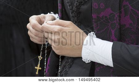 CAGLIARI, ITALY - May 1, 2014: 358 ^ Religious Procession of Sant'Efisio - Sardinia - detail of hands holding up a religious chain