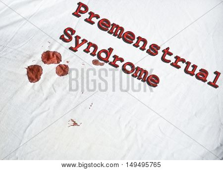 Premenstrual Syndrome sign on white sheet with blood