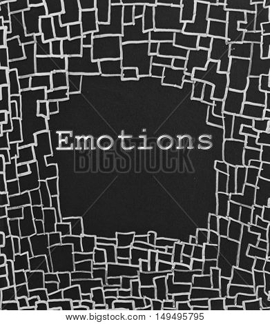 the emotions sign written on abstract blackboard