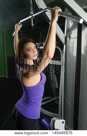 fitness, sport, powerlifting and people concept - sporty woman exercising in gym