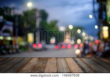 wooden terrace and City light with Bokeh night.Mock up for display or montage of productBusiness presentation