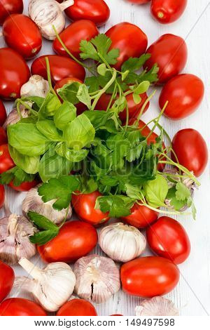 Tomatoes, Basil And Garlic Scattered Over On The Table