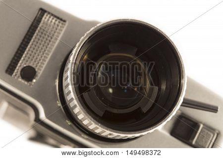 Vintage movie camera close up on white background