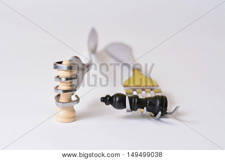 Chess pieces in the hands of forks