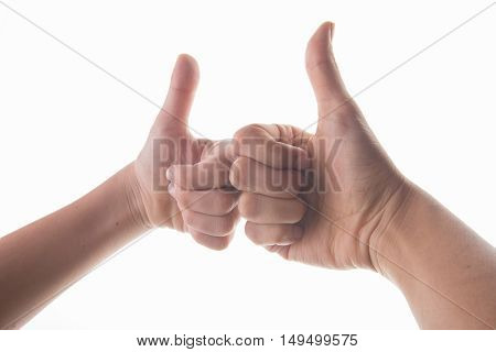 Hand of mom and son thumb up to each other