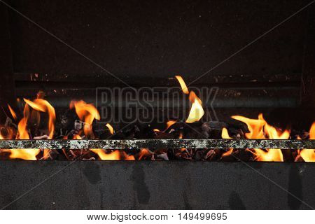 Fire Burning In Black Oven. Close Up