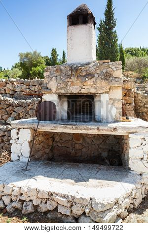 White Stone Oven In Summer Garden