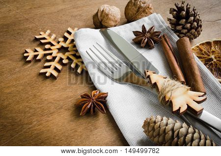 Christmas table place setting with christmas decorations. Selective focus space for text. Rustic stile.