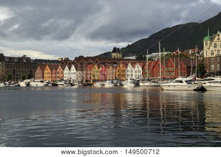 BERGEN, NORWAY - JULY 2, 2016: Waterfront Bryggen is the only such block era of the Hanseatic League a major tourist attraction and a business card of the city.