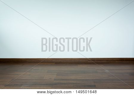 Empty Room Interior, White Mortar Wall Background And Wood Laminate Floor In Residential House