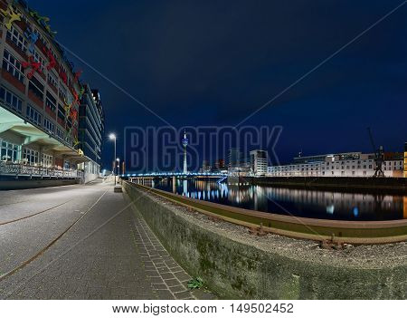 DUESSELDORF, GERMANY - JUNE 29, 2016: Blue hour and artificial light create a scenic atmosphere at media harbor.