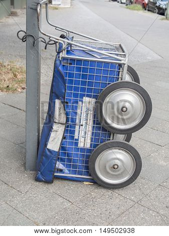 BERLIN GERMANY - SEPTEMBER 29 2016: Newspaper cart for doing a paper route for Berlin newspapers Berliner Morgenpost and Berliner Woche