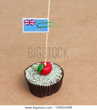 Flag of Tuvalu on cupcake on wood background