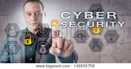 Experienced male information security professional is monitoring CYBER SECURITY onscreen. Information technology concept for IT security computer security management and computer network security.