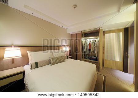 SHANGHAI - NOV 05, 2015: Modern bedroom with tv in apartments of IFC Residence hotel