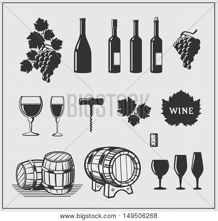 Wine set: bottle, grapes, corkscrew, wine glasses.