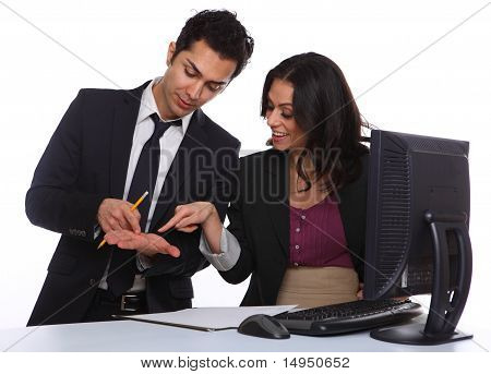 Businesscouple Solving A Problem Near A Computer