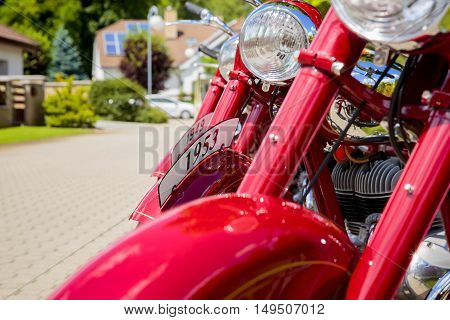 Vintage motorcycles in a row. Detailed view on headlights and front fenders.