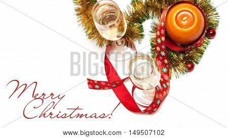 Merry Christmas greeting card made of two glasses of champagne yellow and green tinsel with red christmas balls red ribbon with snowflakes and orange candle with chinese hieroglyph for rooster horizontal top view